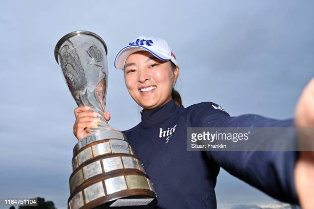 Jin Young Ko of South Korea imitates a selfie as she poses with the trophy following the Evian Championship at Evian Resort Golf Club on July 28 2019...