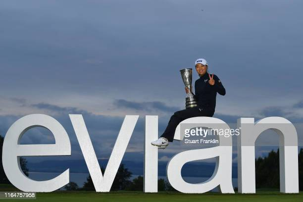 Jin Young Ko of South Korea poses for a photograph with the trophy following victory in the Evian Championship at Evian Resort Golf Club on July 28...