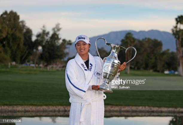Jin Young Ko of South Korea poses with the Dinah Shore Trophy after winning the ANA Inspiration on the Dinah Shore course at Mission Hills Country...
