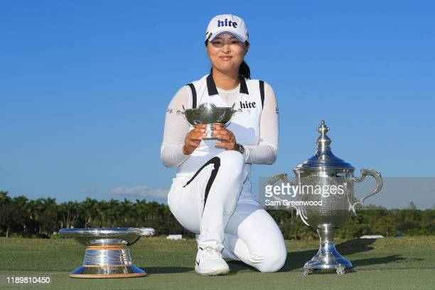 Jin Young Ko of South Korea poses with the Rolex Annika Major Award Vare Trophy and the Rolex Player of the Year trophy after the final round of the...