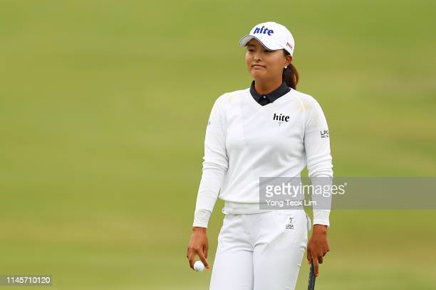 Jin Young Ko of South Korea reacts after sinking her putt on the first hole during the final round of the HUGELAIR PREMIA LA Open at Wilshire Country...