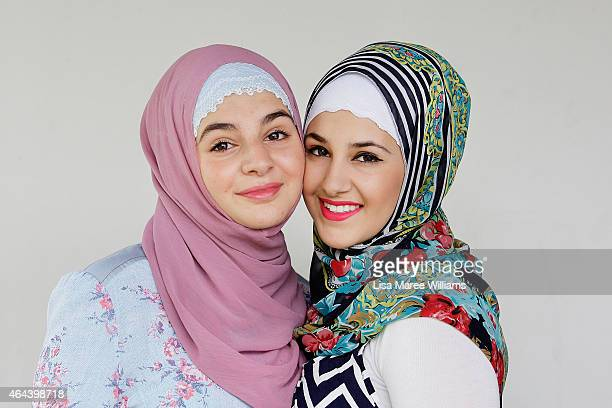 Jinaan Agha and Rose Agha pose for a portrait whilst visiting Sara Elmir's home clothing studio on December 4 2014 in Bankstown Australia Sara Elmir...