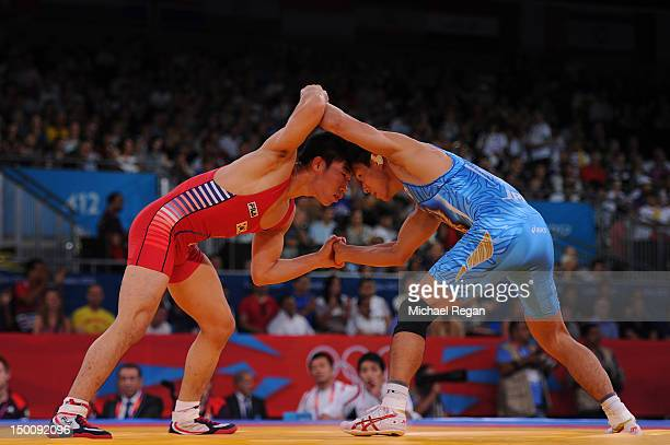 Jincheol Kim of Korea and Shinichi Yumoto of Japan compete in the Men's Freestyle 55 kg Wrestling on Day 14 of the London 2012 Olympic Games at ExCeL...