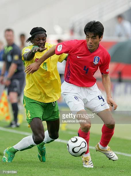 JinChul Choi of South Korea and Emmanuel Adebayor of Togo battle for the ball during the FIFA World Cup Germany 2006 Group G match between South...