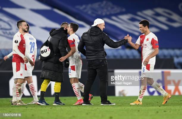 Jindrich Trpisovsky, Head Coach of Slavia Praha and Alexander Bah of Slavia Praha celebrate following their team's victory in the UEFA Europa League...