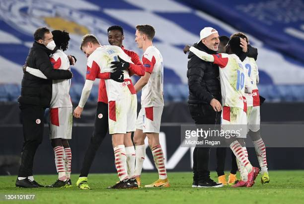 Jindrich Trpisovsky, Head Coach of Slavia Praha celebrates with Oscar Dorley of Slavia Praha following their team's victory in the UEFA Europa League...