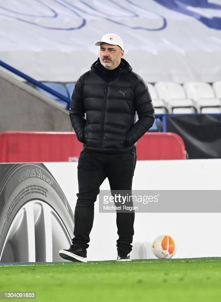 Jindrich Trpisovsky, Head Coach of Slavia Praha looks on during the UEFA Europa League Round of 32 match between Leicester City and Slavia Praha at...