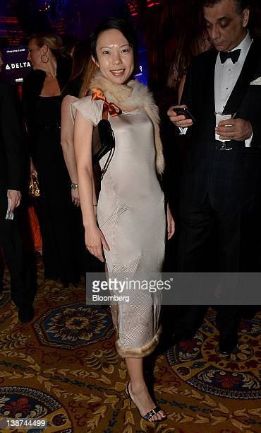 Jing An, commercial mortgage strategist at Goldman Sachs & Co., stands for a photograph during the AmFAR benefit at Cipriani Wall Street in New York,...