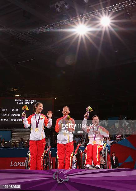 Jing Rong Baili Wu and Fang Yao of China celebrate winning the Gold Medal in the Women's Team Wheelchair Fencing on day 9 of the London 2012...