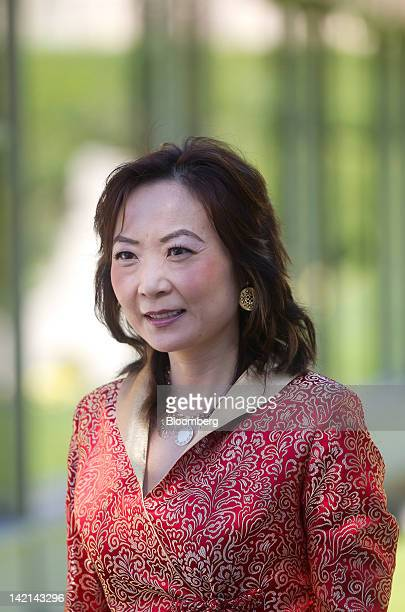 Jing Ulrich, managing director and chairman of global markets for China at JPMorgan Chase & Co., poses for photographers at the Ambrosetti Workshop...