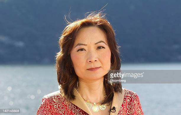 Jing Ulrich, managing director and chairman of global markets for China at JPMorgan Chase & Co., pauses during a television interview at the...