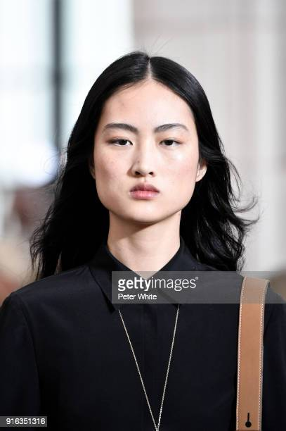 Jing Wen walks the runway at the Tory Burch Fall Winter 2018 Fashion Show during New York Fashion Week at Bridge Market on February 9 2018 in New...