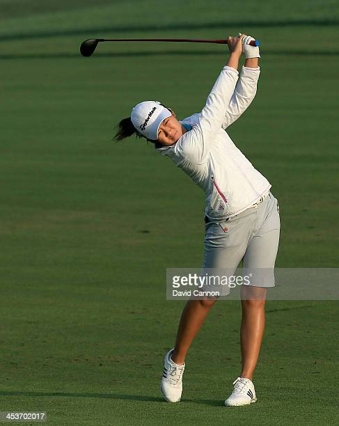 Jing Yan of China plays her second shot on the par 5 10th hole during the second round of the 2013 Omega Dubai Ladies Masters on the Majilis Course...