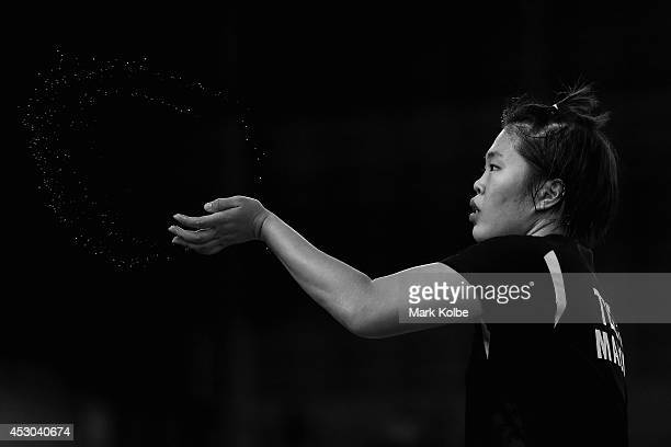 Jing Yi Tee of Malaysia flicks away sweat as she competes in her women's singles badminton quarter-final match at Emirates Arena during day nine of...