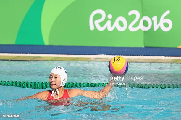 Jing Zhang of China passes during the Preliminary Round Group B Womens Waterpolo match between China and Hungary on Day 4 of the Rio 2016 Olympic...
