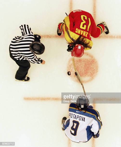 Jing Zhang of team China faces off with Olga Potapova of team Kazakhstan in a IIHF World Women's Championships qualifying game at the...