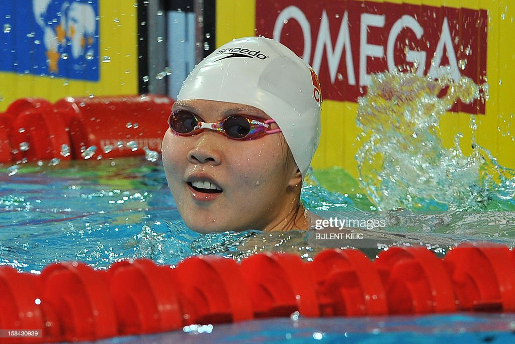 Jing Zhao of China celebrates her victory in the women's 50m backstroke final during the Short Course Swimming World Championships in Istanbul on December 16, 2012.