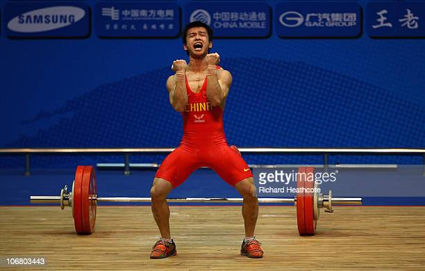 Jingbiao Wu of China reacts to a lift while competing in the Men's 56kg Weightlifting competition at the Dongguan Gymnasium during day one of the...