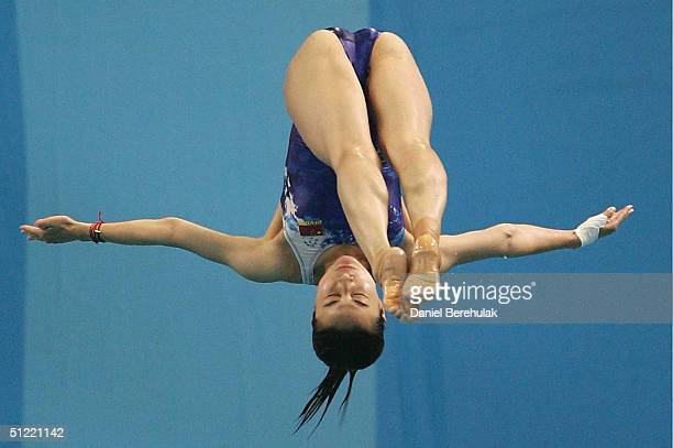 Jingjing Guo of China competes in the women's diving 3 metre springboard semifinal event on August 26 2004 during the Athens 2004 Summer Olympic...
