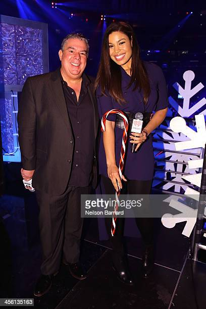 Jingle Ball host Elvis Duran and singer Jordin Sparks pose backstage at Z100's Jingle Ball 2013 presented by Aeropostale at Madison Square Garden on...