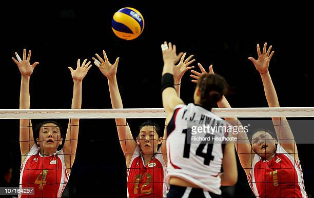 Jingsi Shen Ming Xue and Xian Zhang of China go up for the ball against Youn Joo Hwang of South Korea in the second set during the Women's Gold Medal...