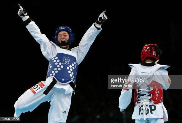 Jingyu Wu of China celebrates victory in the Women's 49kg Taekwondo Final match against Brigitte Yague Enrique of Spain on Day 12 of the London 2012...