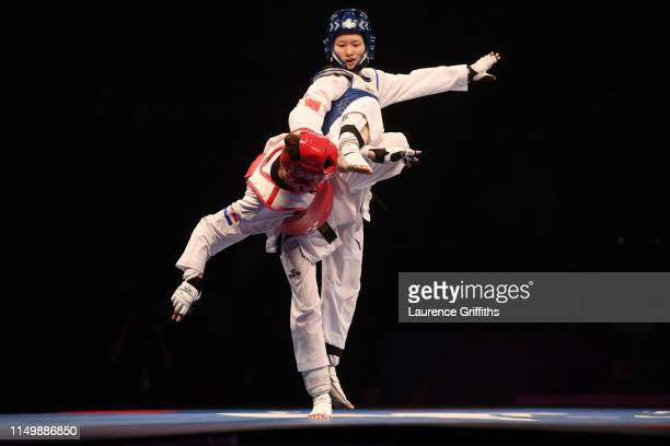 Jingyu Wu of China competes against Kristina Tomic of Croatia in the Semi Final of the Women's 49kg during Day 3 of the World Taekwondo Championships...