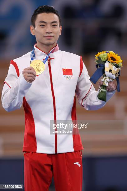 Jingyuan Zou of Team China poses with the gold medal for the Men's Parallel Bars Final during the medal ceremony on day eleven of the Tokyo 2020...