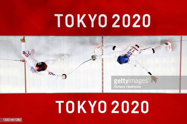 Jinhwa Jung of Team South Korea and Jan Kuf of Team Czech Republic during the Fencing Ranked Round of the Men's Modern Pentathlon on day thirteen of...