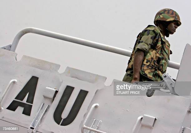 An African Union peacekeeper from the Uganda People's Defence Force participates in a flaggingoff parade 01 March 2007 presided over by President...