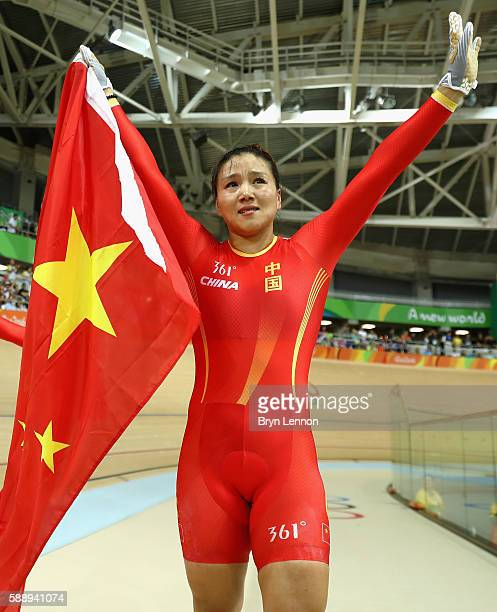 Jinjie Gong of Team China celebrates winning the gold medal after beating Team Russia in the Women's Team Sprint final for gold on Day 7 of the Rio...