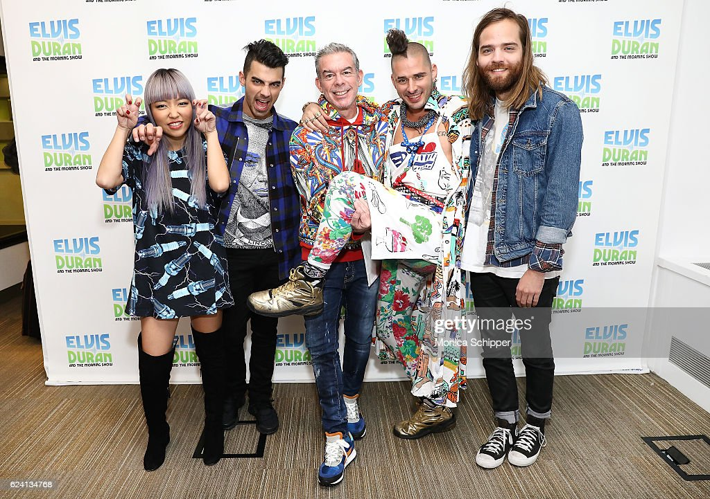 JinJoo Lee and Joe Jonas of band DNCE, host Elvis Duran and Cole Whittle and Jack Lawless of band DNCE pose for a photo when DNCE visits 'The Elvis Duran Z100 Morning Show' at Z100 Studio on November 18, 2016 in New York City.