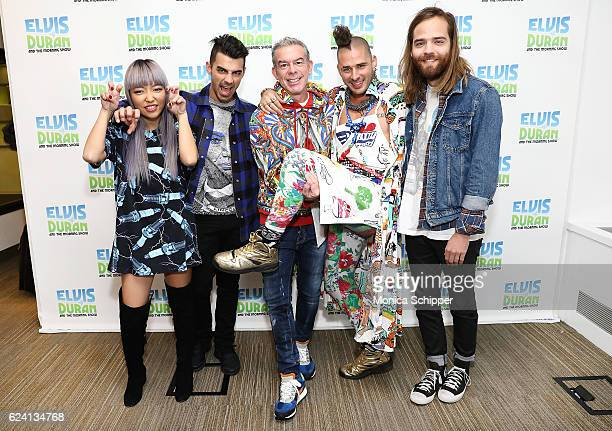 JinJoo Lee and Joe Jonas of band DNCE host Elvis Duran and Cole Whittle and Jack Lawless of band DNCE pose for a photo when DNCE visits The Elvis...