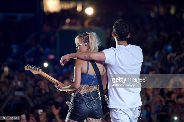 JinJoo Lee and Joe Jonas of DNCE perform at the annual Isle of MTV Malta event at Il Fosos Square on June 27 2017 in Floriana Malta