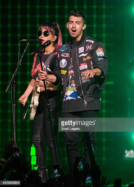 JinJoo Lee and Joe Jonas of DNCE perform during the Revival Tour at The Palace of Auburn Hills on June 25, 2016 in Auburn Hills, Michigan.