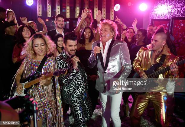 JinJoo Lee and Joe Jonas of DNCE Sir Rod Stewart Cole Whittle of DNCE perform during a pretaping for the 2017 MTV Video Music Awards at the Palms...