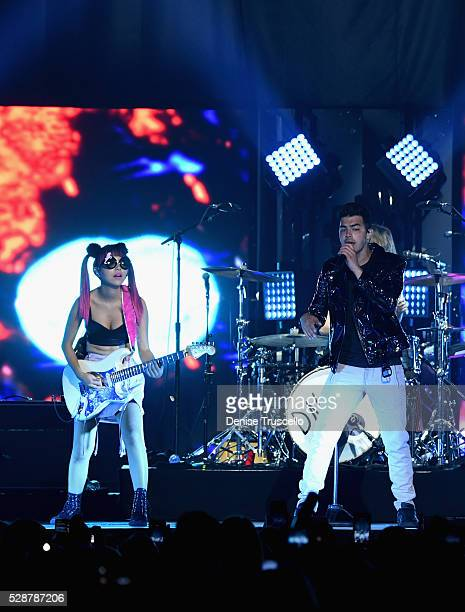 JinJoo Lee and singer Joe Jonas of DNCE perform during opening night of the Selena Gomez 'Revival World Tour' at the Mandalay Bay Events Center on...