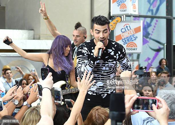 JinJoo Lee Cole Whittle and Joe Jonas of the band DNCE perform on NBC's Today at Rockefeller Plaza on August 26 2016 in New York City