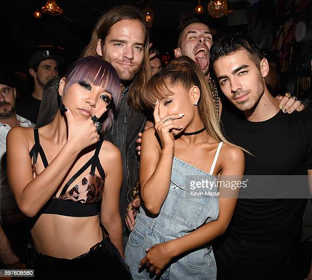 JinJoo Lee Jack Lawles Cole Whittle and Joe Jonas of DNCE pose with singer Ariana Grande duringthe 2016 MTV Video Music Awards Republic Records After...
