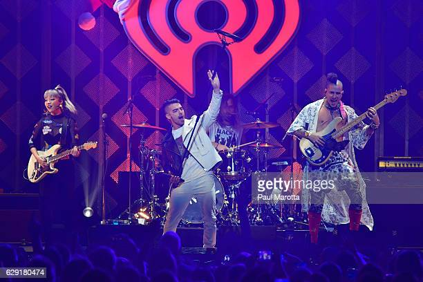 JinJoo Lee Jack Lawless Joe Jonas and Cole Whittle of DNCE perform on stage during KISS 108's Jingle Ball 2016 at TD Garden on December 11 2016 in...