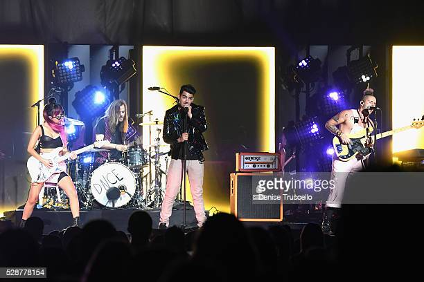 JinJoo Lee Jack Lawless singer Joe Jonas and Cole Whittle of DNCE perform during opening night of the Selena Gomez 'Revival World Tour' at the...
