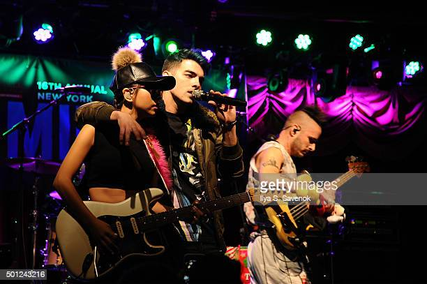 JinJoo Lee Joe Jonas and Cole Whittle of DNCE performs onstage at TJ Martell Foundation's 16th Annual New York Family Day at Brooklyn Bowl on...