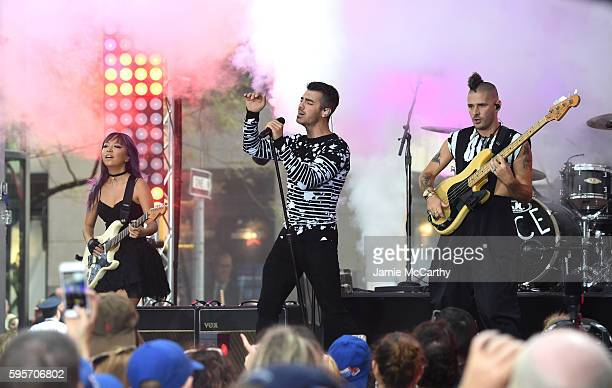 JinJoo Lee Joe Jonas and Cole Whittle of the band DNCE perform on NBC's Today at Rockefeller Plaza on August 26 2016 in New York City