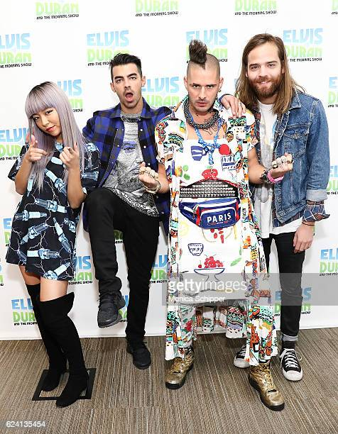 JinJoo Lee Joe Jonas Cole Whittle and Jack Lawless of band DNCE pose for a photo when DNCE visits The Elvis Duran Z100 Morning Show at Z100 Studio on...