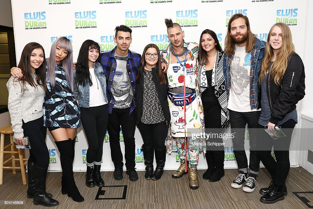 JinJoo Lee, Joe Jonas, Cole Whittle and Jack Lawless of band DNCE pose for a photo with fans when DNCE visits 'The Elvis Duran Z100 Morning Show' at Z100 Studio on November 18, 2016 in New York City.