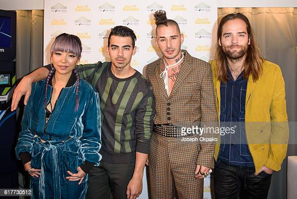 JinJoo Lee Joe Jonas Cole Whittle and Jack Lawless of DNCE pose backstage at the Ray of Sunshine concert at Wembley Arena on October 24 2016 in...