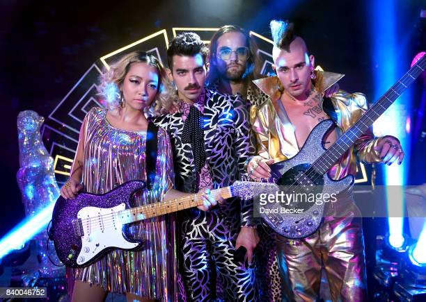 JinJoo Lee Joe Jonas Jack Lawless and Cole Whittle of DNCE perform during a pretaping for the 2017 MTV Video Music Awards at the Palms Casino Resort...