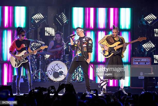 JinJoo Lee Joe Jonas Jack Lawless and Cole Whittle of DNCE performs during the Revival Tour at The Palace of Auburn Hills on June 25 2016 in Auburn...