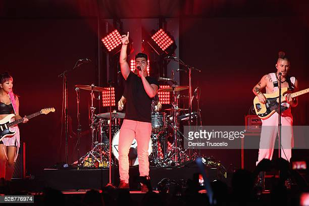 JinJoo Lee singer Joe Jonas and Cole Whittle of DNCE perform during opening night of the Selena Gomez 'Revival World Tour' at the Mandalay Bay Events...