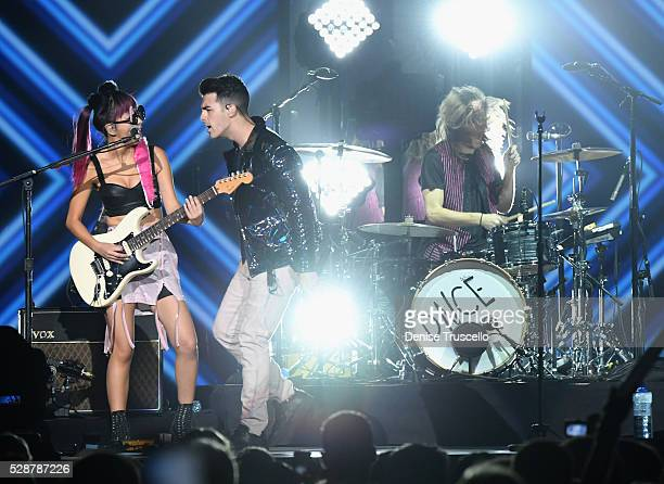 JinJoo Lee singer Joe Jonas and Jack Lawless of DNCE perform during opening night of the Selena Gomez 'Revival World Tour' at the Mandalay Bay Events...
